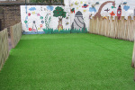 London old car park made in to a small play area with artificial grass