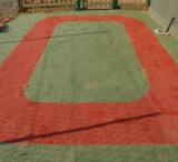 A free draining outdoor carpet that can be used as a safety surface.